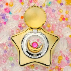 "The Sailormoon Moonlight Memory Music Box which plays the theme song ""Moonlight Legend"""